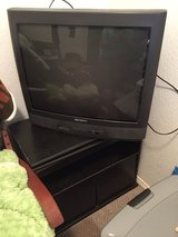 Tv stand and tv in Fort Bliss, Texas