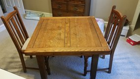 Slide-leaf Oak table with 2 chairs in Conroe, Texas