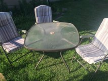 Table and 3 lawn chairs in Lawton, Oklahoma