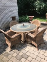 Wicker patio table and chairs in Aurora, Illinois