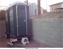 Portable PortaJohn on trailer in Yucca Valley, California