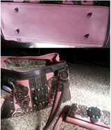 Concealed carry purse and matching wallet, like new, in Baytown, Texas