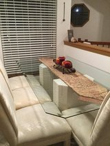 Glass rectangular dining room table and 4 cushioned chairs. in Great Lakes, Illinois