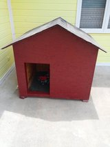 Large red doghouse in Fort Riley, Kansas