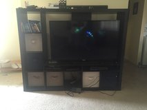TV stand with baskets in Fort Irwin, California