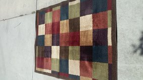 Multi colored Square rug in Fort Riley, Kansas