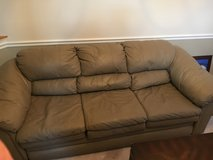 Brown leather love seat and sofa in Fairfax, Virginia