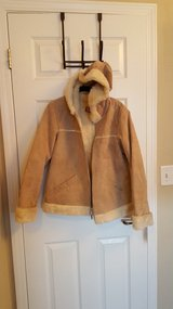 Tan leather and faux fur jacket in Belleville, Illinois