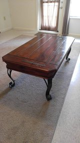 Wooden coffee table with iron legs in Hinesville, Georgia