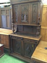 Carved oak harvest cupboard in Lakenheath, UK