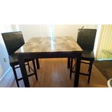 Table with black bar stools. in Fort Lewis, Washington