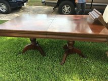 Wood dinning table in Lackland AFB, Texas