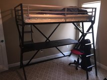 Twin bunk bed with desk attached in Moody AFB, Georgia