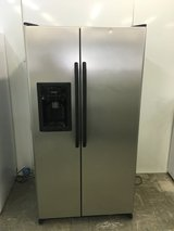 GE Stainless Side by Side refrigerator, Don't miss this deal! in Fort Benning, Georgia