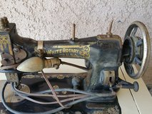 White rotary sewing machine works in Yucca Valley, California
