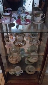 curio cabinet with antique teacups in Bellevue, Nebraska