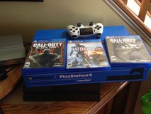 Ps4 with 3 games and wireless controller with charger in Dover AFB, Delaware
