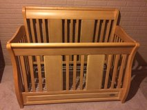 Convertible crib bed with changing table in Lockport, Illinois