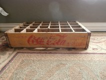 Vintage yellow wooden coca cola crate in Cleveland, Texas
