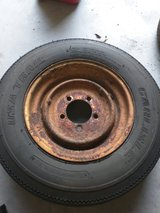 New Trailer tire mounted on used rim, 5.30-12.   Rim has surface rust in Camp Lejeune, North Carolina