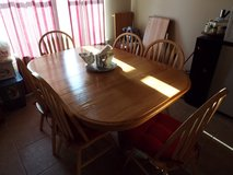 MUST SELL - Solid Oak dining room table plus 6 chairs and 2 leafs in Fort Polk, Louisiana