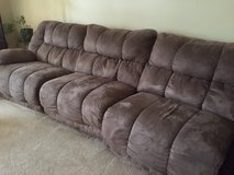 Large taupe colored sectional with recliner feature in Dover AFB, Delaware