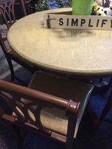 Refurbised burlap round table and four antique chairs in Elizabethtown, Kentucky