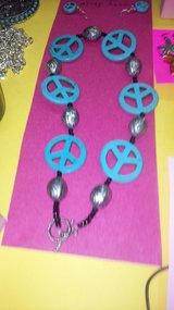 peace sign necklace and earrings in Yucca Valley, California