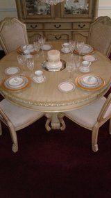 Round Table four chairs in Ivory in Conroe, Texas