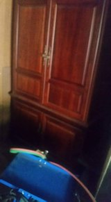 cherry wood TV armoire in Conroe, Texas