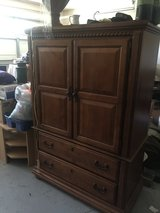 Brown bedroom entertainment cabinet in Hinesville, Georgia