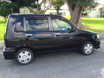 2002 Nissan Cube with 2 year JCI in Okinawa, Japan