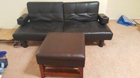 Leather futon and ottoman in Fort Bliss, Texas