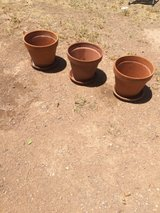 3 Large clay terracotta pots with plates in Fort Bliss, Texas