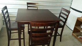 Height dining table set with 4 chairs chocolate color in El Paso, Texas