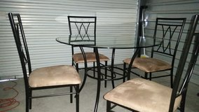 4 chairs dining set glass top metal frame in Fort Bliss, Texas
