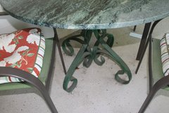 Beautiful Green Marble topped wrought iron patio set with four chairs priced to sell in Moody AFB, Georgia