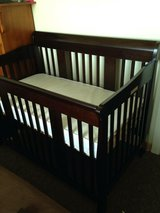 Convertible crib with mattress and baby gates in Fort Bragg, North Carolina