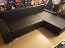 Black couch with built in storage and chase in Ramstein, Germany