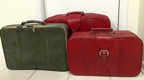 Set of three vintage suitcases red green in Beaufort, South Carolina