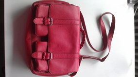 Red over shoulder bag in Ramstein, Germany