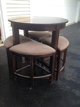 Round cherry wood table with stools in Bartlett, Illinois