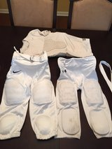 (2) Padded Football Pants Sz YL and (1) Padded Compression Shirt (Sz XL) in Houston, Texas