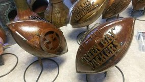 Metal New Orleans Saints footballs in New Orleans, Louisiana