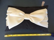 Black pillow with cream bow in Vacaville, California
