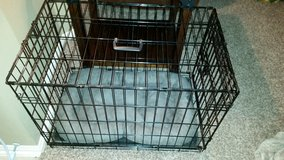 Wire dog crate in Conroe, Texas