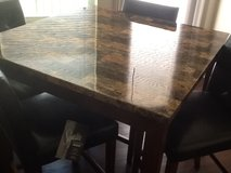 Table with 4 chairs. Buyer picks up in MacDill AFB, FL
