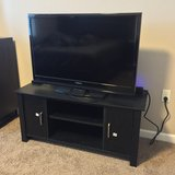 "35"" Insignia TV w/ Brand New TV Stand in Bellevue, Nebraska"