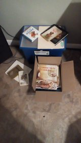 Box of assorted cookbooks in Baytown, Texas