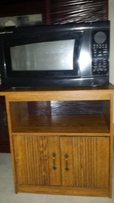Microwave and stand in Fort Bliss, Texas